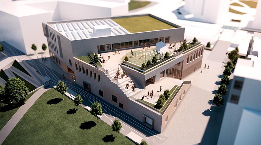 Havainnekuvassa on Vuosaaren uusi lukio ylhäältä kuvattuna.