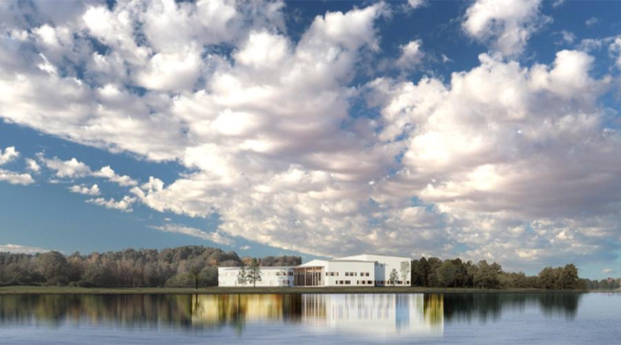 Kuvassa on havainnekuva Ivalon koulukeskuksesta, joka kohoaa Ivalojoen rannan jylhään maisemaan.