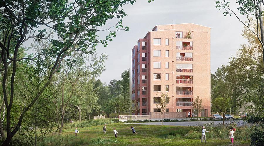 Kuvassa on puiden keskelläuusi kerrostalo, jossa panostetaan yhteisöllisyyteen ja energiatehokkuuteen.