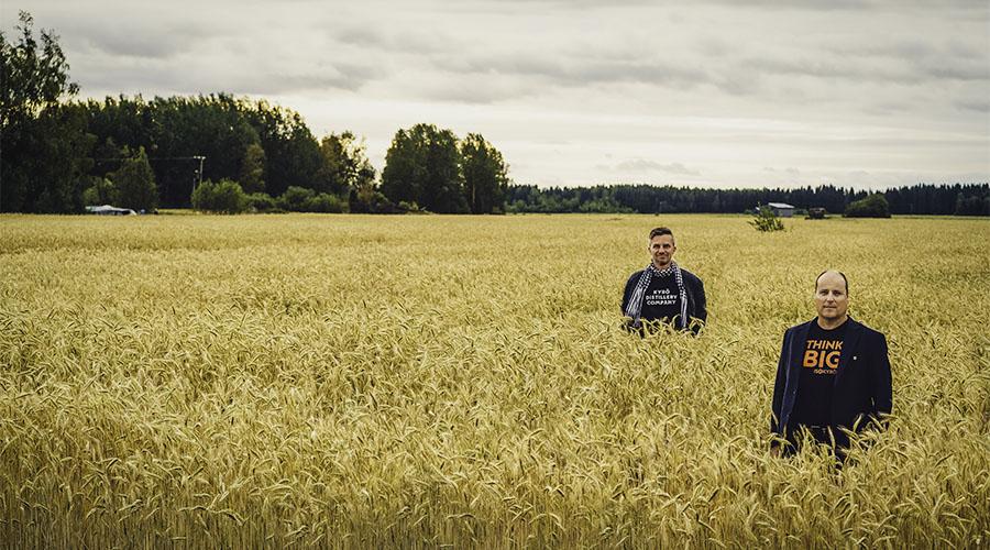 Miko Heinilä, Kyrö Distillery Company's Distillery Manager and Tero Kankaanpää, Mayor of Isokyrö standing on a rye field.