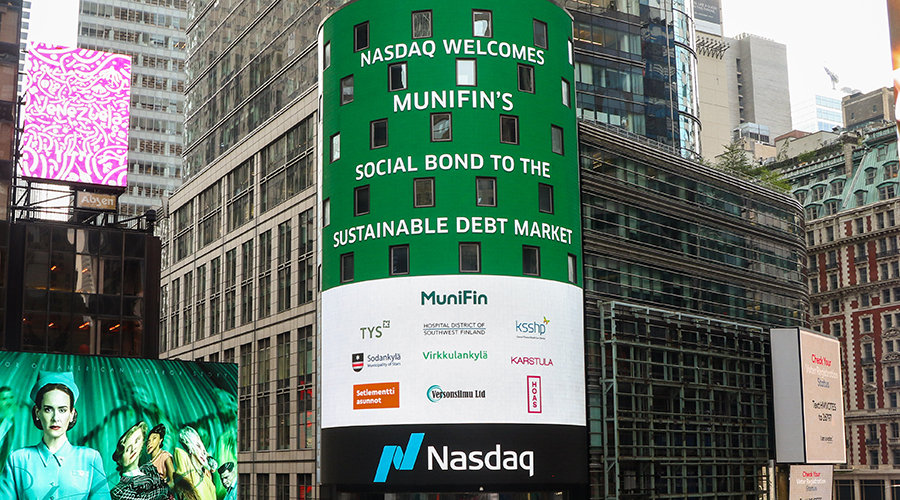"""A picture of Nasdaq´s billboard with the text """" Nasdaq Helsinki welcomes Municipality Finance as its First Social Bond Issuer""""."""