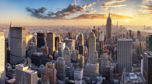Decorative picture: Sun rising behind skyscrapers in New York City, USA.